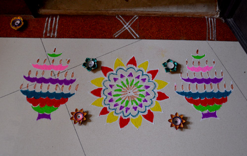 karthigai celebrations with rangoli and pori urundai