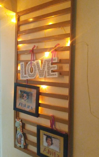 crib rail to a photo frame wall